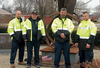 Highway department crew maintains veterans memorial